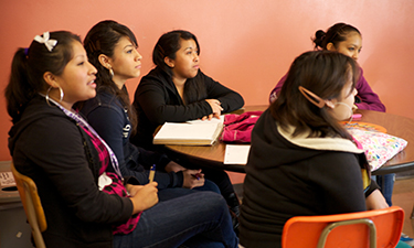English Language Learners at a table