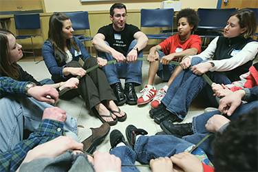 students and mentor sitting in a circle