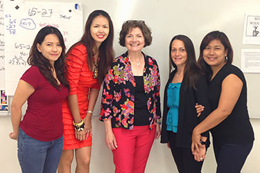 Claire Gates poses with 4 other teachers from the Commonwealth of Northern Mariana Islands
