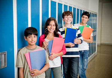 Photo of students standing near lockers