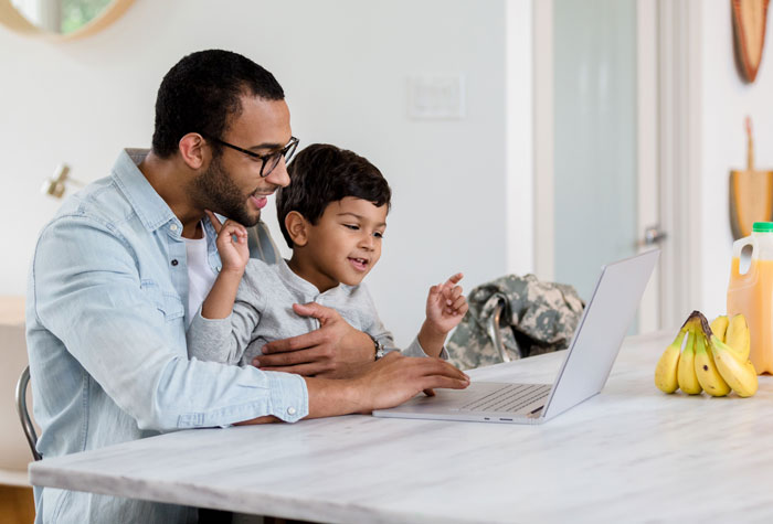 graphic of parent and child using a computer
