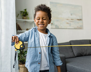 Photo of a kid with measuring tape