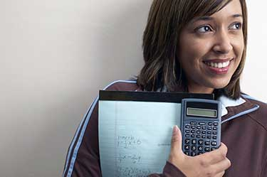 High school student with a calculator