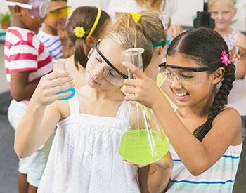 Two students doing chemistry experiment