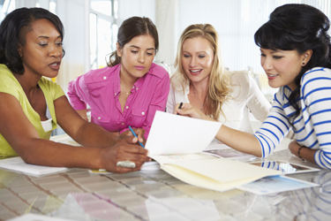 four female teachers working together