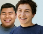 Two male students looking at the camera smiling