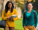 2 college students walking together