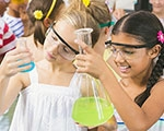 Girls doing experiment in chemistry lab