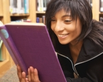 Female student reading in a school library
