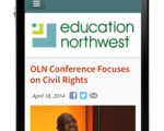 Picture of the EdNW website displayed on a mobile phone