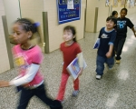 Students walking in a school hallway