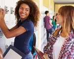 Image of two teens standing next to a locker