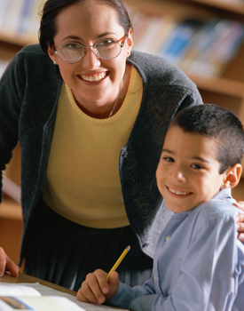 A teacher and student in a classroom