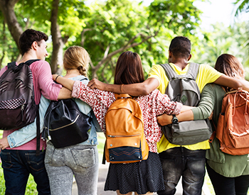 Photo of students with backpacks.