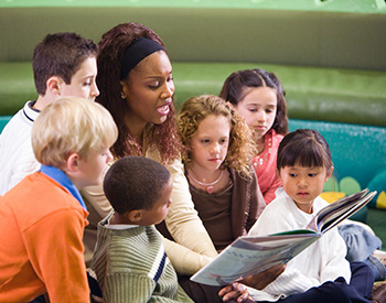 Photo of teacher reading to students